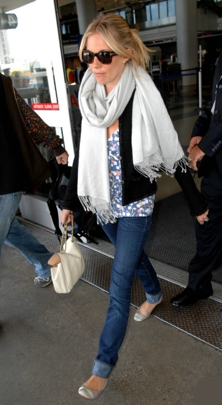 Borrow this look from Sienna Miller..Always fly with a scarf that can double as a blanket on the plane.